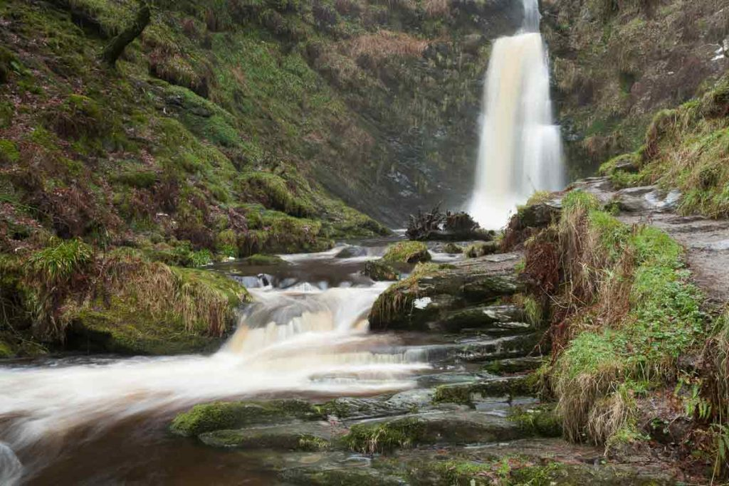 Pistyll Rhaeadr is a waterfall in Wales. It's one of the best natural wonders in the UK.