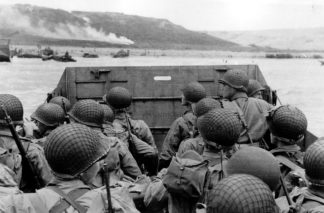 Old photograph of American troops approaching Omaha Beach on D-Day