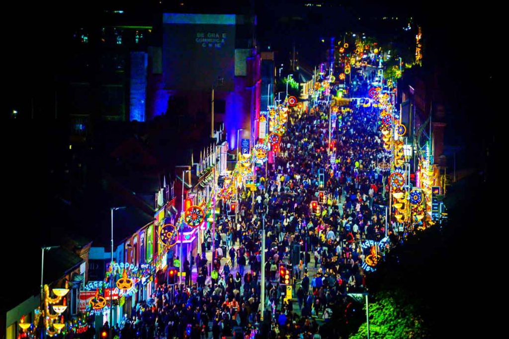Photo of neon lights on a street packed with people on Diwali in Leicester