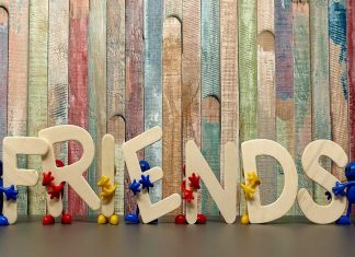 "Photo of the word ""friends"" in front of a multicoloured background"