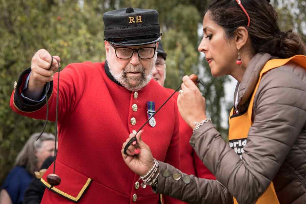 Photo of a man and a woman playing conkers