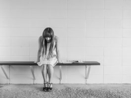 Photo of a girl sitting alone