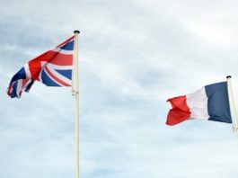 Photo of UK and French flags flying side by side