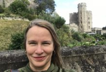Photo of the author, mature student Melissa Gebara, in front of a castle in the UK.