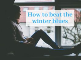 """Photo of a girl sitting by a window with text that says """"how to beat the winter blues"""""""