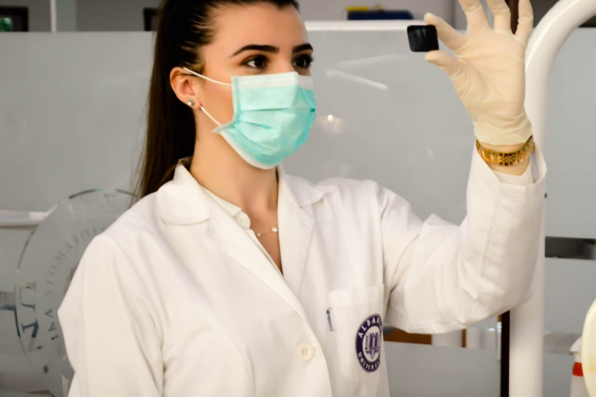 A student dentist looks at a slice