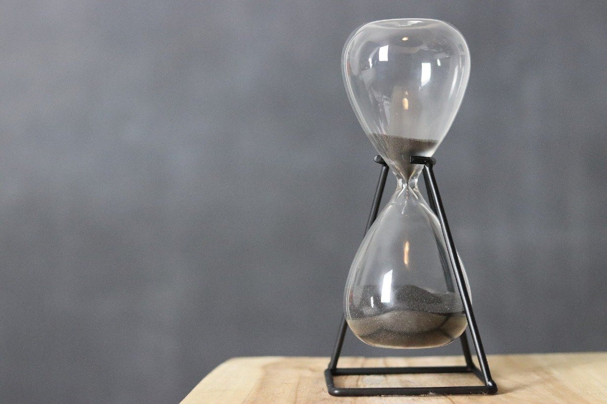 An hour glass showing time running out
