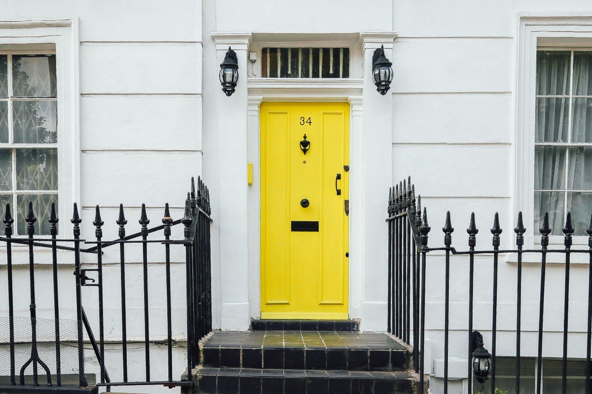 Yellow front door of a city home