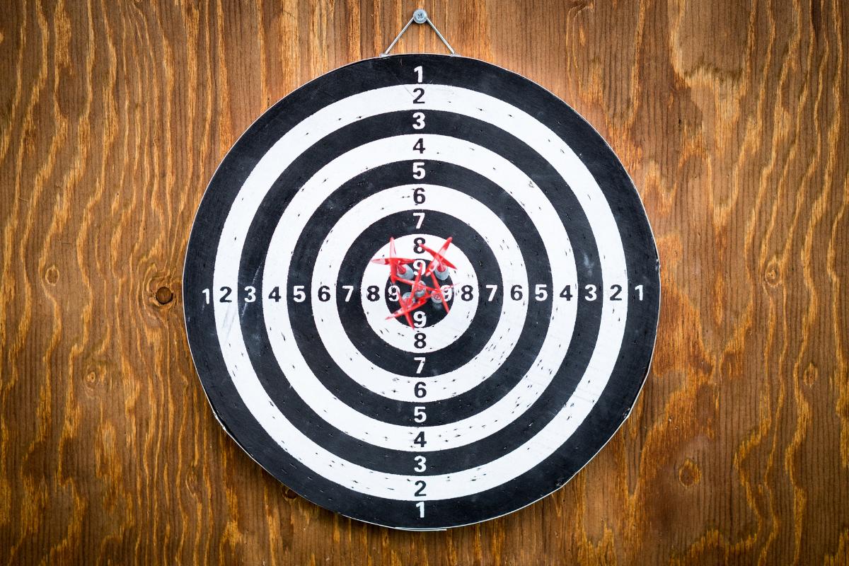 A dartboard with darts in the bullseye